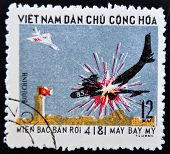 VIETNAM - CIRCA 1970: A stamp printed in Vietnam shows breaking down a fighter plane to another
