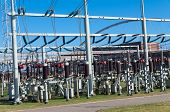 stock photo of transformer  - detail of a transformer station under a blue sky - JPG