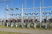 picture of transformer  - detail of a transformer station under a blue sky - JPG