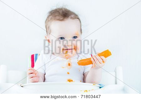 Sweet Baby Eating Her First Carrot