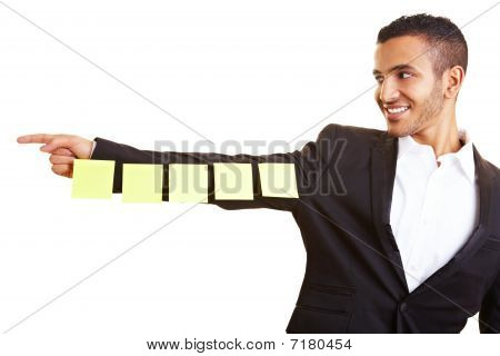 Manager Holding Sticky Notes