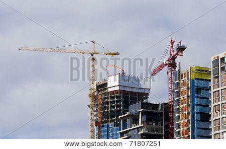 Cranes Constructing Commercial Office Buildings