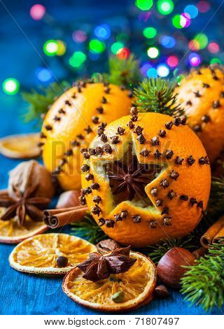 Oranges pierced with cloves,Christmas spices and nuts