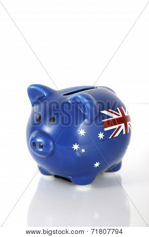 Handpainted Money Piggy Bank With Australian Flag On White Reflective Surface.