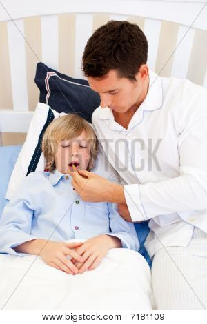 Attentive Father Checking His Son's Temperature