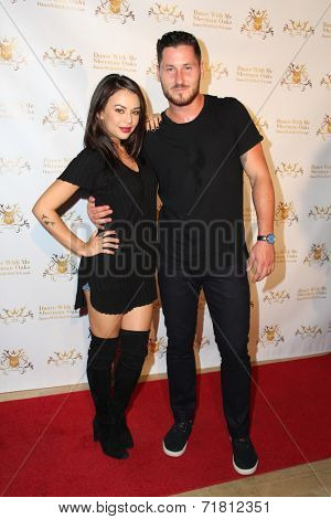 LOS ANGELES - SEP 10:  Janel Parrish, Valentin Chmerkovskiy at the Dance With Me USA Grand Opening at Dance With Me Studio on September 10, 2014 in Sherman Oaks, CA