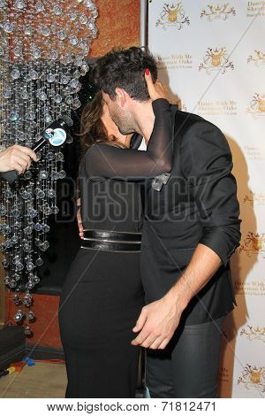 LOS ANGELES - SEP 10:  Leah Remini, Maksim Chmerkovskiy at the Dance With Me USA Grand Opening at Dance With Me Studio on September 10, 2014 in Sherman Oaks, CA