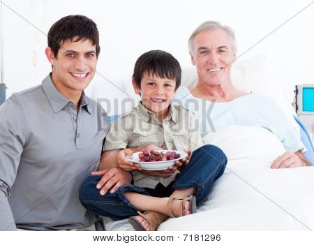 Father And Son Visiting Grandfather