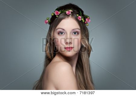 Beautiful Young Woman With Garland From Small Roses