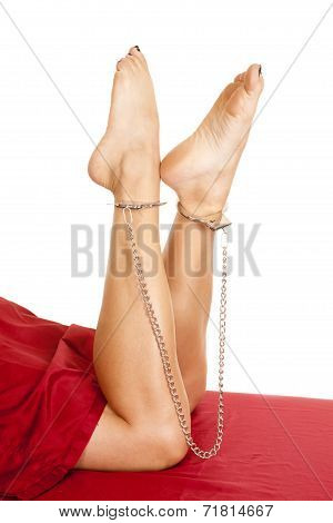 Woman Legs Red Sheet Toes Up Handcuff