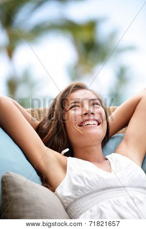 Sofa Woman relaxing enjoying lifestyle in luxury outdoor day dreaming and thinking looking happy up smiling cheerful. Beautiful young multicultural Asian Caucasian female model in her 20s.