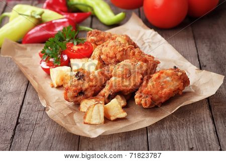 Southern fried chicken wings with spicy potato