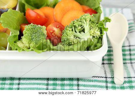 Tasty vegetarian food in plastic box, close up
