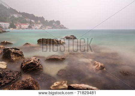 Heavy Rainstorm And Fog On Rocky Beach Near Omis, Dalmatia, Croatia