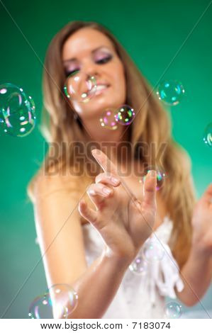 Young Fashion Woman With Soap Bubbles