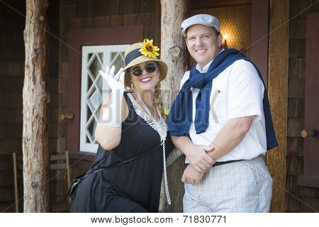 Young Attractive Couple Dressed in Outfits from the Twenties Era.