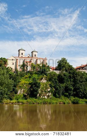 The Benedictine Abbey in Tyniec in Poland with wisla river on blue sky background