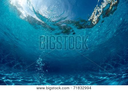 Underwater shot of the empty swimming pool with bubbles