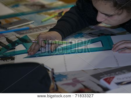 Girl At Home With Tools And Square Ruler