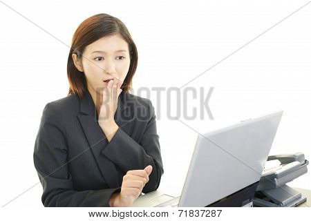 Young Asian businesswoman of uneasy look in trouble