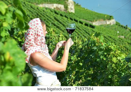 Girl tasting red wine in Lavaux, Switzerland