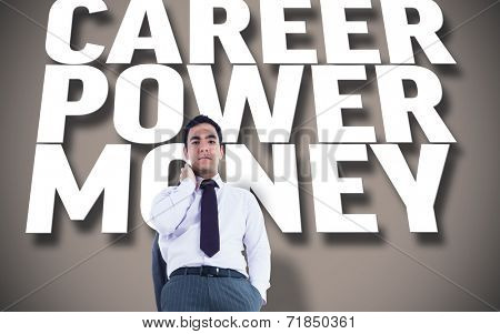 Unsmiling businessman standing against grey background with text