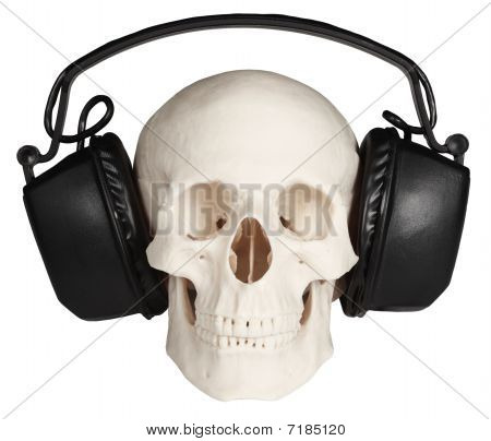 Human Skull With Music Headphones On White Background