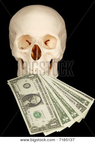 Horrible Skull With Bundle Of Money In Mouth