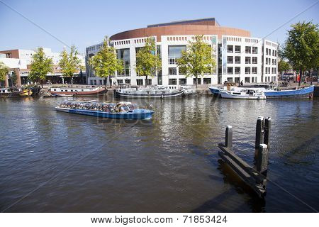 Opera House And Boats In Amstel River