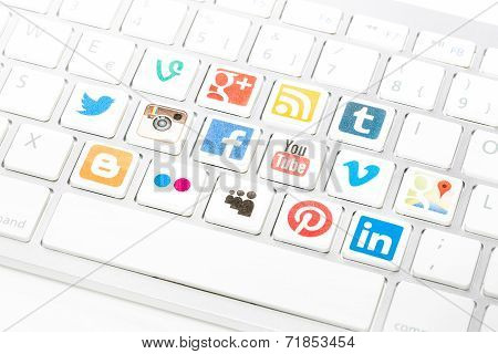 Social Media Logotype Collection Printed And Placed On White Computer Keyboard.