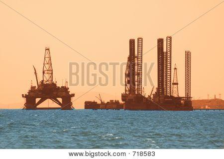 Oil Rig During Sunset In Baku, Azerbaijan In Caspian Sea