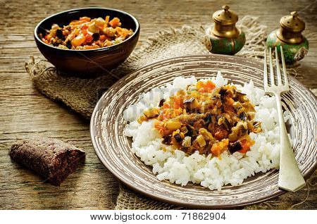 Rice With Sauce Of Eggplant, Peppers And Tomatoes