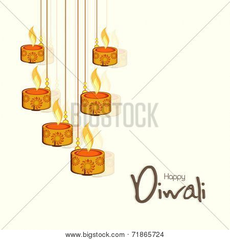 Beautiful floral design decorated illuminated oil lit lamps on beige background for Happy Diwali celebrations.