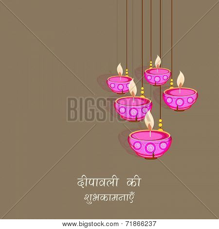 Beautiful greeting card design on occasion of Hindu community festival with illuminated hanging oil lit lamps on brown background.