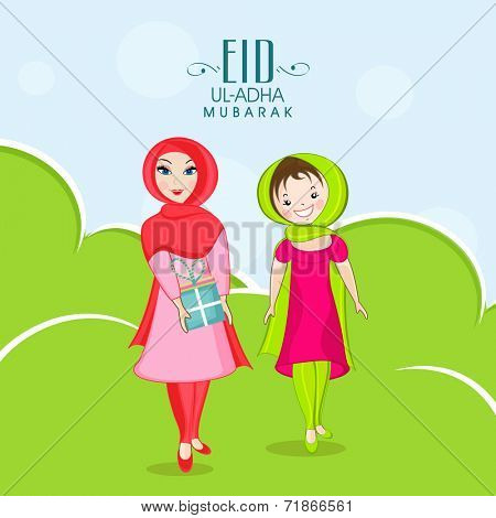 Young Muslim ladies with gift box on nature background for Muslim community festival Eid-Ul-Adha celebrations.
