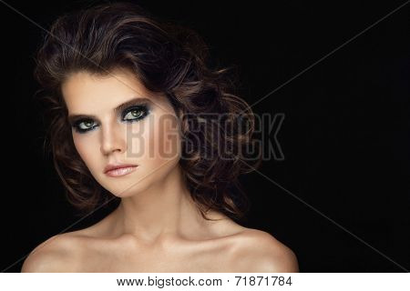 Portrait of young beautiful woman with stylish make-up and curly hair