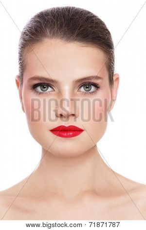 Portrait of young beautiful woman with freckles and red lipstick over white background