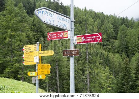 FERRET, SWITZERLAND - AUGUST 30: Tour du Mont Blanc direction signs. The popular tour goes through France, Italy and Switzerland, and is clearly signalised throughout.. August 30, 2014 in Ferret.