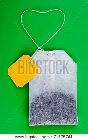 Tea Bag On Green Background