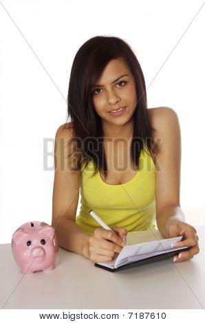 Woman writing check.