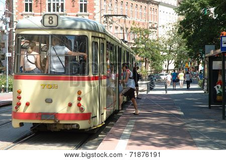 People Getting On And Off The Tram In Poznan, Poland.
