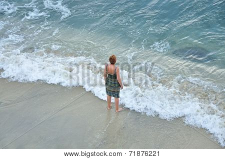 Woman standing on the sandy beach