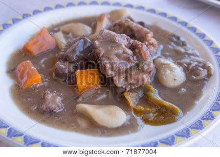 Cooked Oxtail meat on a plate, shot taken in Portugal
