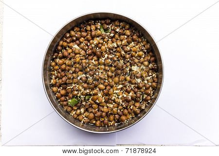 Boiled black chickpea gram mixed with simmered grated coconut, curry leaves & mustard