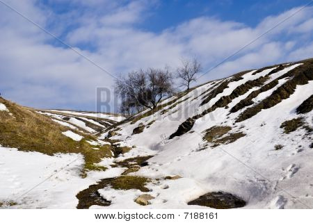 Spring Gully Slopes With Patches Of Snow