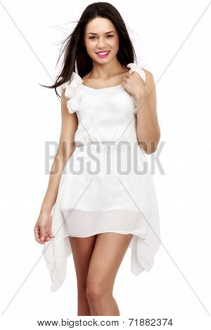 Beautiful woman in white dress on white