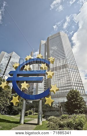 FRANKFURT AM MAIN, GERMANY -  MAY 14, 2014: Euro sign in front of the European Central Bank (Europaeische Zentral Bank) headquarter building