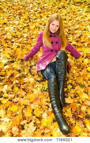 pretty smiling girl in autumn park