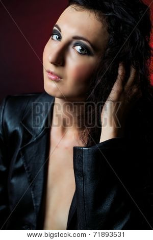brunette woman wearing a leather jacket