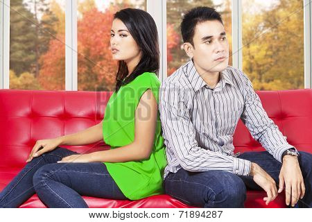 Couple Quarreling And Sitting Separately